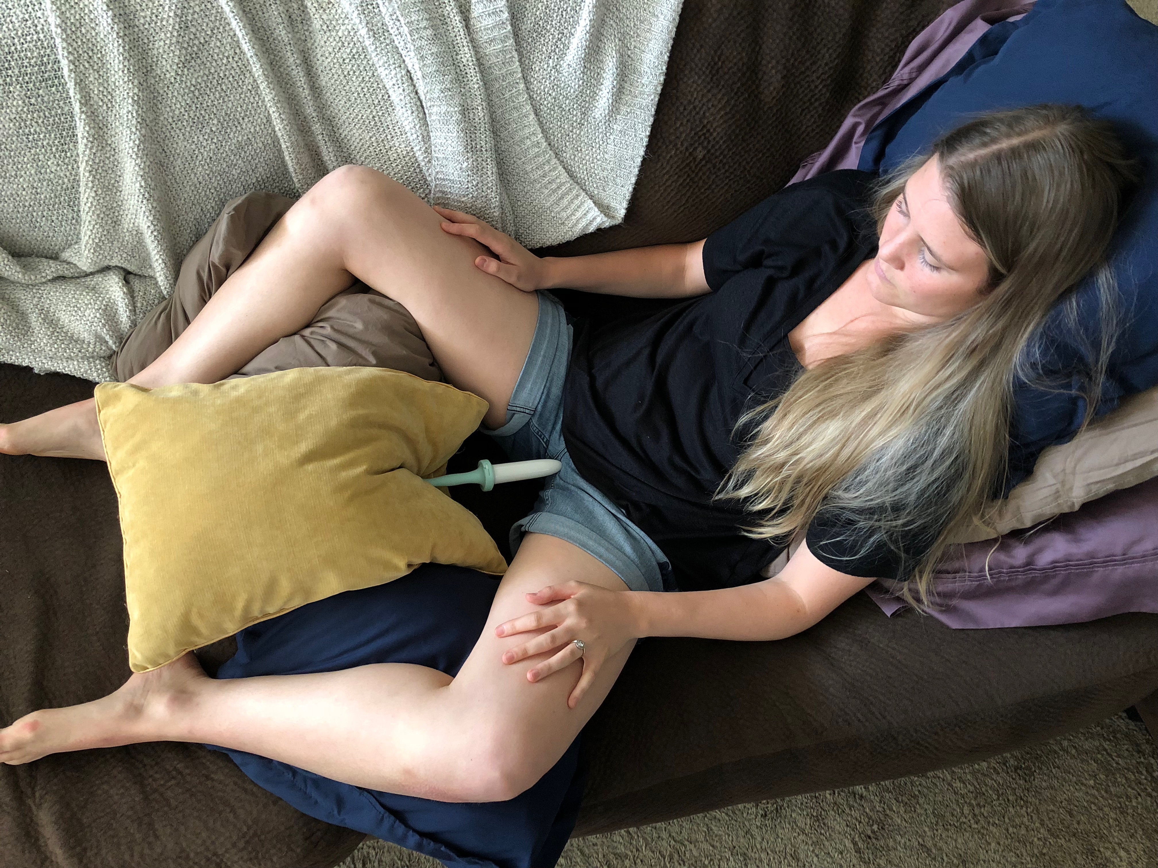 An example of me using a pillow to support the dilator once it is inserted.